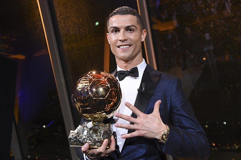 This image provided by L'Equipe on Friday December 8, 2017 shows Portuguese soccer player Cristiano Ronaldo holding the Ballon d' Or (Golden Ball) he received, on Thursday December 7, 2017 in Paris. Photo: Franck Faugere, L'Equipe, via AP