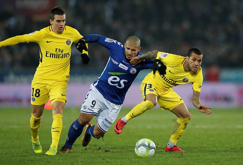 Paris Saint-Germainu2019s Giovani Lo Celso and Dani Alves in action with Strasbourgu2019s Idriss Saadi during Ligue 1 match between Strasbourg and Paris St Germain, at Stade de la Meinau, in Strasbourg, France, on December 2, 2017. Photo: Reuters