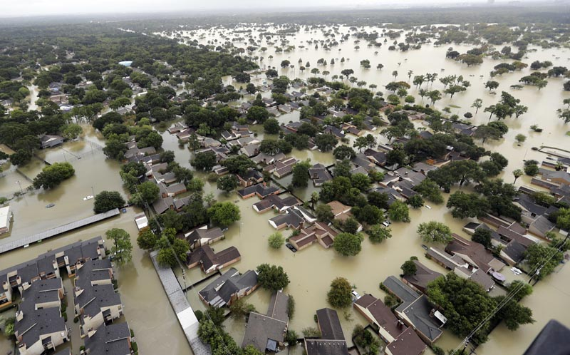 Water from Addicks Reservoir flows into neighborhoods as floodwaters from Tropical Storm Harvey rise in Houston., US, on  this Tuesday, August. 29, 2017. Photo: AP/ File