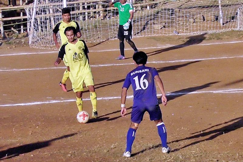 Agni Rupandehi XI player looks to pass a ball to him teammates against Sunsari XI during semi-final of ninth Ruslan Falgunanda Gold Cup in Phidim of Panchthar district, on Thursday, December 28, 2017. Photo: Laxmi Gautam
