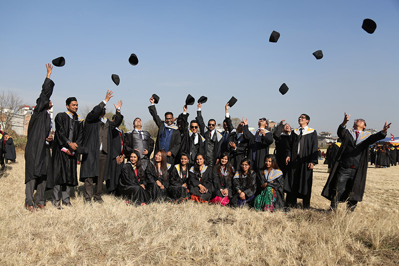 Tribhuvan University new graduates celebrating by throwing mortar boards in air on graduation day, at Pulchowk in Lalitpur district, on Sunday, December 31, 2017. Photo: RSS
