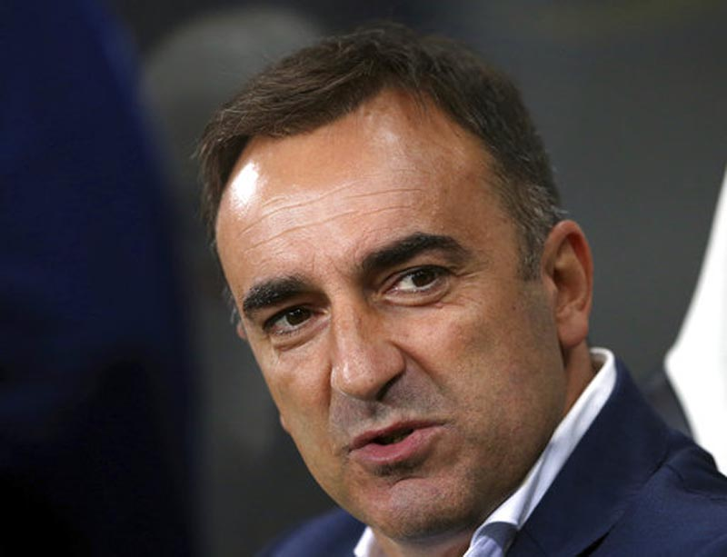 FILE - In this Wednesday, Sept. 23, 2015 file photo, Sheffield Wednesday's manager Carlos Carvalhal awaits the start of the English League Cup third round soccer match between Newcastle United and Sheffield Wednesday at St James' Park, Newcastle, England. Swansea has hired Carlos Carvalhal as manager of the struggling Premier League club, days after the Portuguese coach left second-tier Sheffield Wednesday. (AP Photo/Scott Heppell, File)