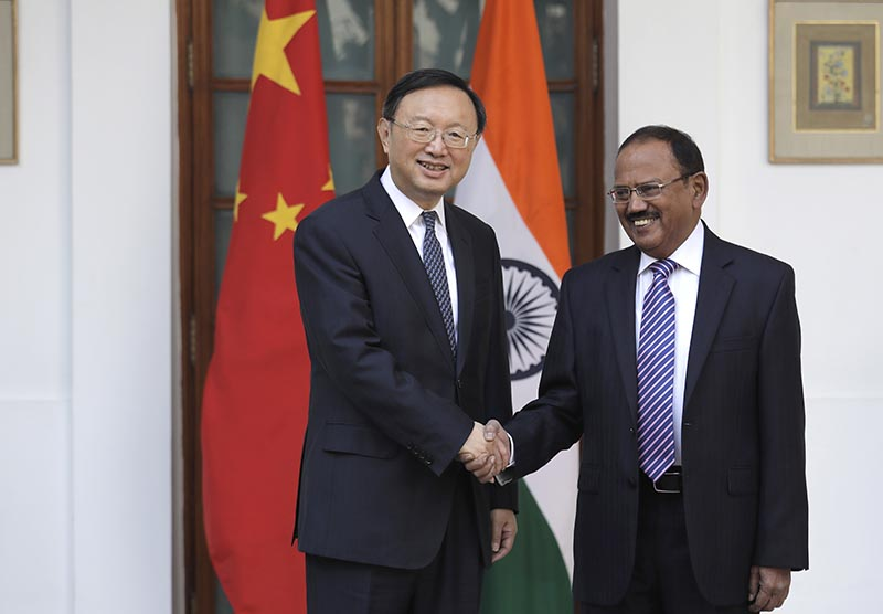 Indian National Security Adviser Ajit Doval, right, poses with Chinese State Councillor Yang Jiechi for a photo before their meeting in New Delhi, India, on Friday, December 22, 2017. Photo: AP