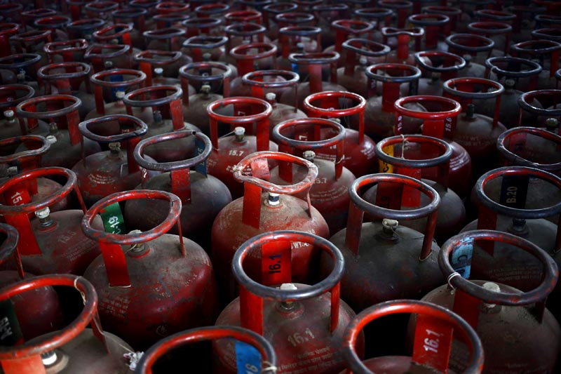 Empty Liquefied Petroleum Gas (LPG) cylinders are seen at a gas distribution centre in Dujana village, India, on October 7, 2015. Photo: Reuters