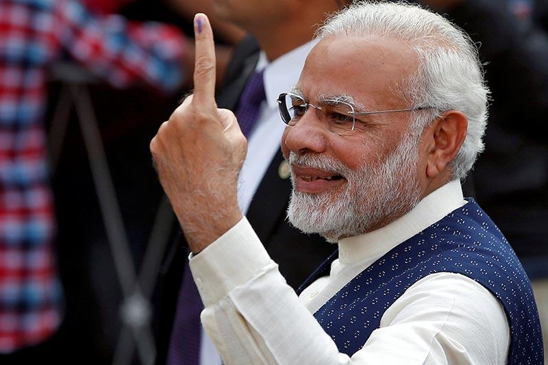 India's Prime Minister Narendra Modi shows his ink-marked finger after casting his vote outside a polling station during the last phase of Gujarat state assembly election in Ahmedabad, India, on  December 14, 2017. Photo: Reuters