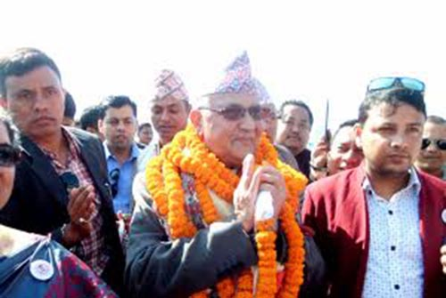 CPN-UML Chairperson KP Sharma Oli greets to the mass, gathered in Jhapa, on Monday, December 11, 2017. Photo: THT