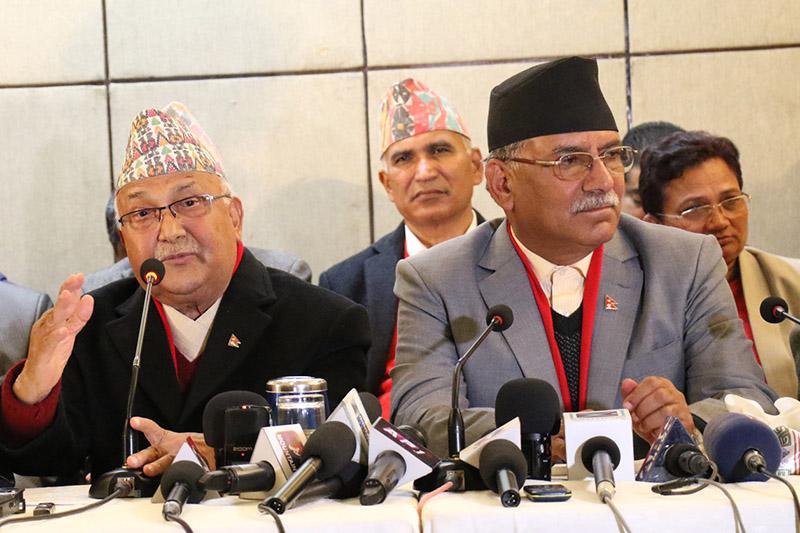 CPN-UML Chair KP Sharma Oli and CPN-MC Chair Pushpa Kamal Dahal speaking to mediapersons in Kathmandu, on Sunday, December 17, 2017. Photo: RSS