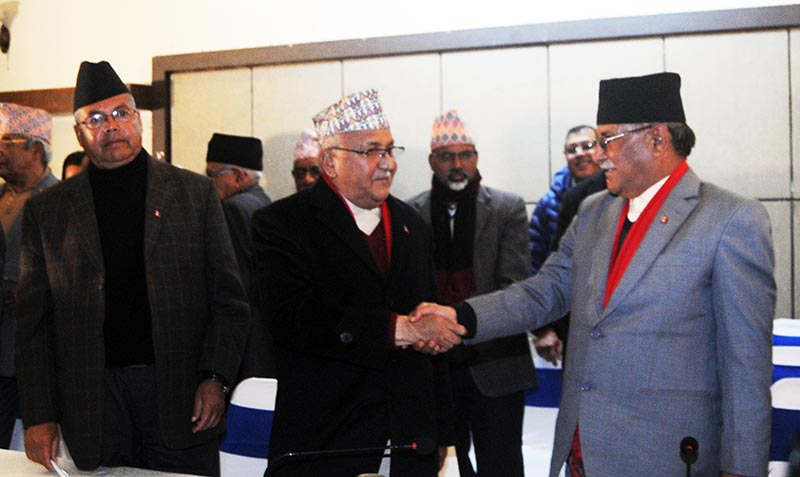 CPN-UML Chair KP Sharma Oli and CPN-Maoist Centre Chair Pushpa Kamal Dahal shaking hands at a joint press conference of the two parties in Durbar Marg, Kathmandu, on Sunday, December 17, 2017. Photo:Balkrishna Thapa Chhetri/THT