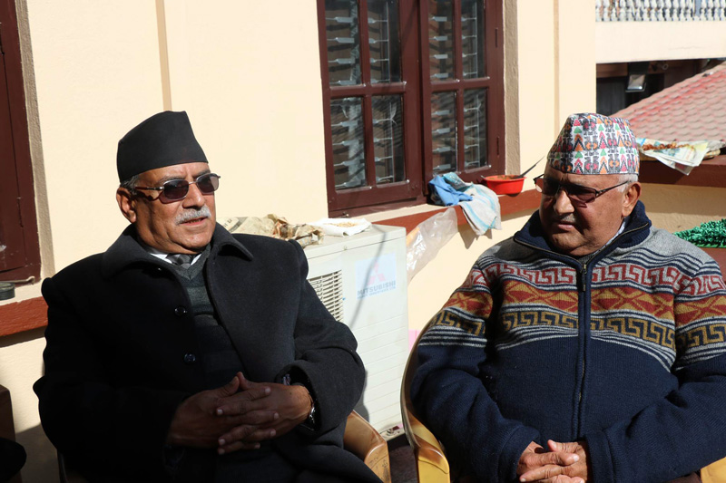 CPN Maoist Centre Chair Pushpa Kamal Dahal (left) and CPN-UML Chair KP Sharma Oli hold a meeting at the latter's residence in Balkot, Bhaktapur, on Wednesday, December 27, 2017. Photo: THT Online