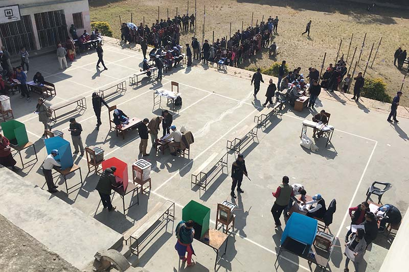Voters stand in queue to cast their ballot in the second phase of provincial and parliamentary elections in Bouddha Multiple Campus in Kathmandu Constituency-3 , on Thursday, December 7, 2017. Photo: Rajesh Gurung
