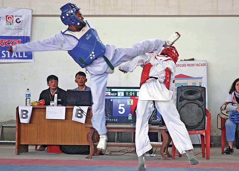 Lila Ram Chaudhary (left) fights against Roshan Gautam during the eighth Korean Ambassador Open Taekwondo Championship in Lalitpur on Saturday. Photo: THT