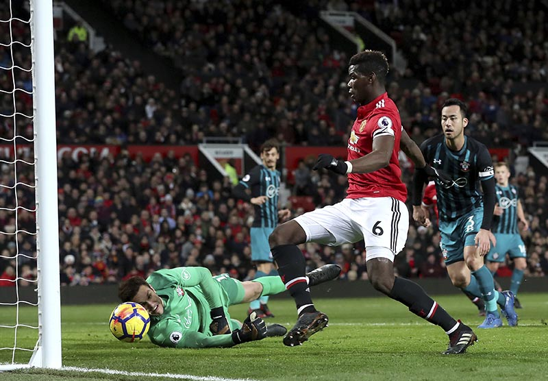 Manchester United's Nemanja Matic shoots at the goal whilst Paul Pogba (centre), follows it in but was ruled off side during the English Premier League soccer match Manchester United versus Southampton at Old Trafford, Manchester, England, on Saturday December 30, 2017. Photo: Martin Rickett/PA via AP