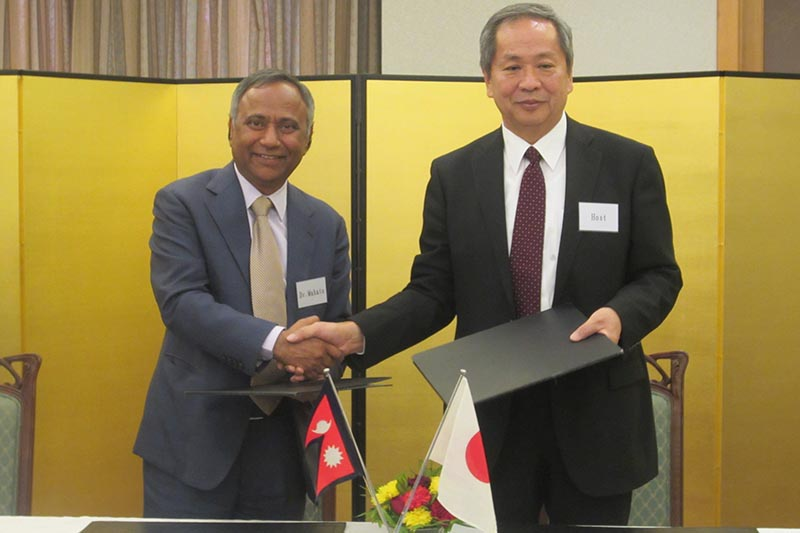 Ambassador of Japan to Nepal Masashi Ogawa (right) and Dr Upendra Mahato (left) during accord signing ceremony, in Kathmandu, on Wednesday, December 13, 2017. Photo courtesy: Embassy of Japan