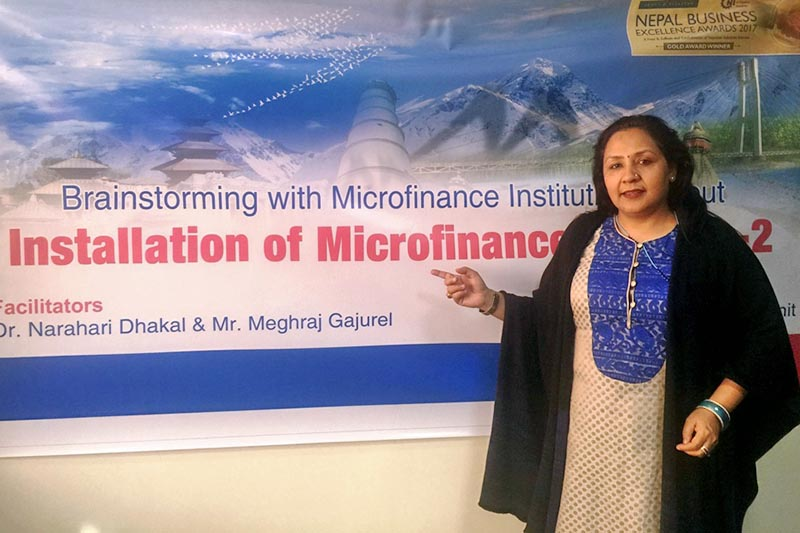 Acting CEO of the Mega Bank giving presentation on Installation of Microfincnce: Version-2 in Kathmandu, on Sunday, December 17, 2017. Coutresy: Mega Bank