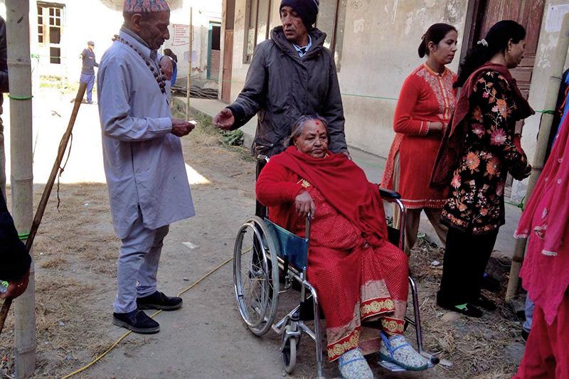 An elderly woman is seen heading towards a polling centre in Nepal Commerce Campus, Minbhawan, Kathmandu Constituency-2, on Thursday, December 7, 2017. Photo: Sabitri Dhakal