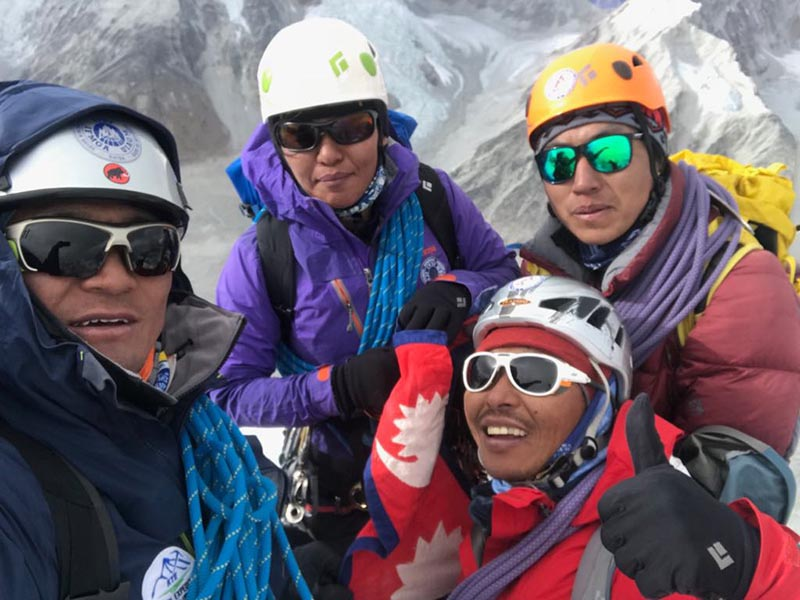 The team of four Sherpas posing for photograph after scaling  Mt Langdung. Photo courtesy: Nima Tenji Sherpa