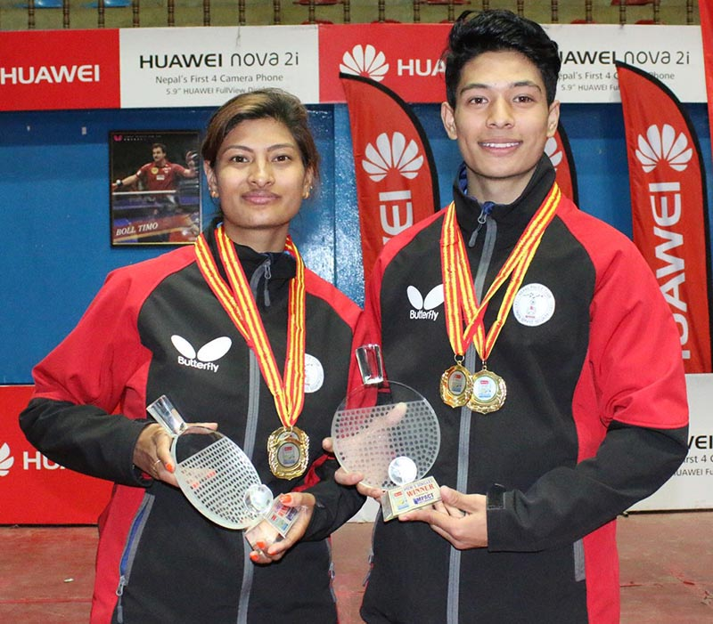 NPCu2019s Nabita Shrestha and Shyantu Shrestha hold their singles trophies of the iMPACT Thamel Open Table Tennis Championship in Kathmandu, on Monday, December 11, 2017. Photo: THT