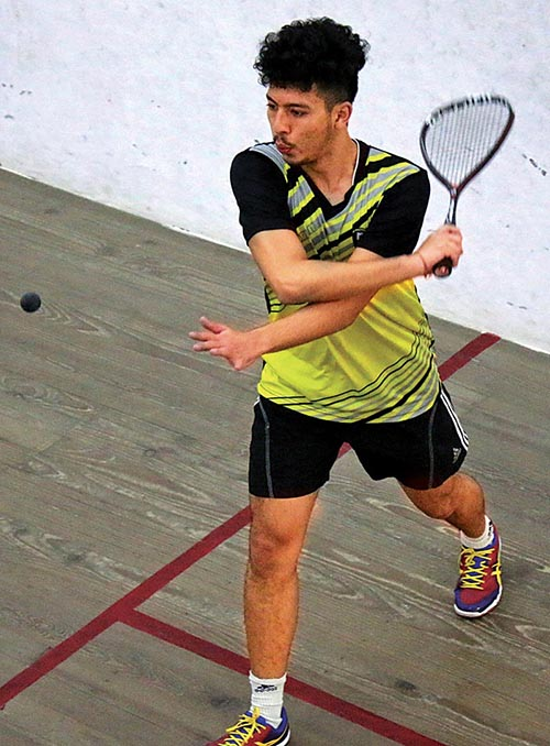 Arhant Keshar Singh in action against Dilip Singh Adhikari during their menu2019s singles match of the 10th National Squash Tournament in Lalitpur on Monday. Photo: THT