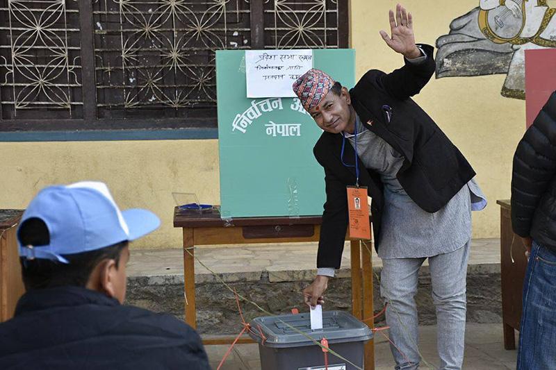 Former Deputy Inspector General (DIG) Nawaraj Silwal casts his vote in Kitini-3 of Godawari Constituency-1, on Thursday, December 7, 2017. Photo: Naresh Shrestha