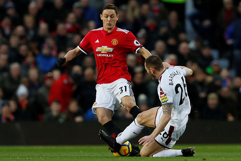 Manchester United's Nemanja Matic in action with Burnley's Phil Bardsley. Photo: Reuters