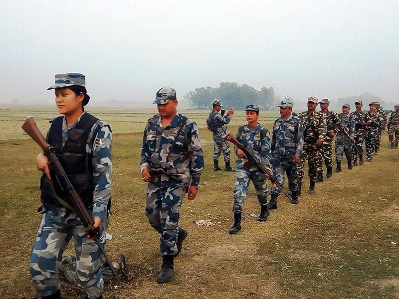 The Armed Police Force (APF) Nepal and Indian Seema Suraksha Bal (SSB) jointly patrol the area along the Nepal-India border, 1.5 kilometre east of Gaur, the district headquarters of Rautahat, on Friday, December 1, 2017. Photo: Prabhat Kumar Jha