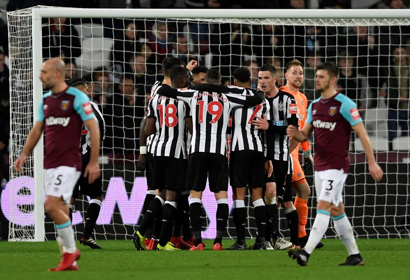 Newcastle United players celebrate after the English Premier League match between Newcastle and West Ham United, at London Stadium, in London, Britain, on December 23, 2017. Photo: Reuters
