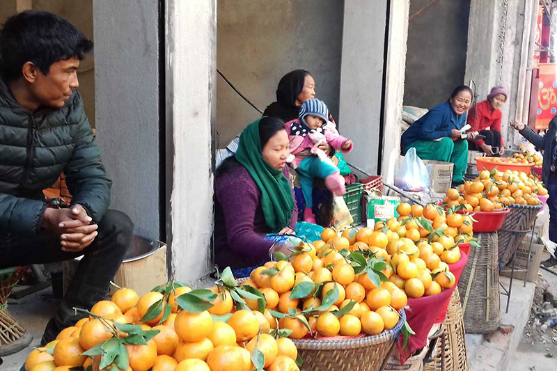 Orange vendors await customers to sell their products in Manakamana of Gorkha district, on Sunday, December 31, 2017. Photo: RSS