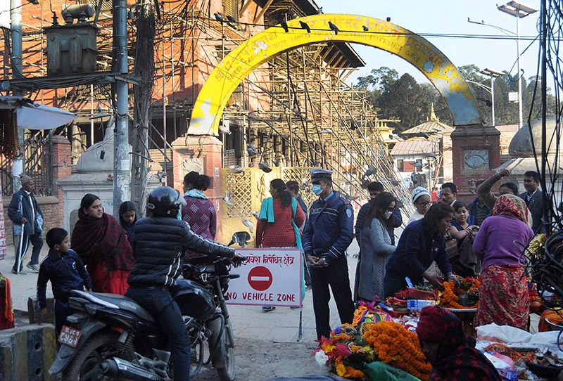 A traffic policeman stopping a biker in front of a no-entry sign at the main gate of Pashupatinath temple, on Tuesday, December 26, 2017. Photo: Balkrishna Thapa Chhetri/THT