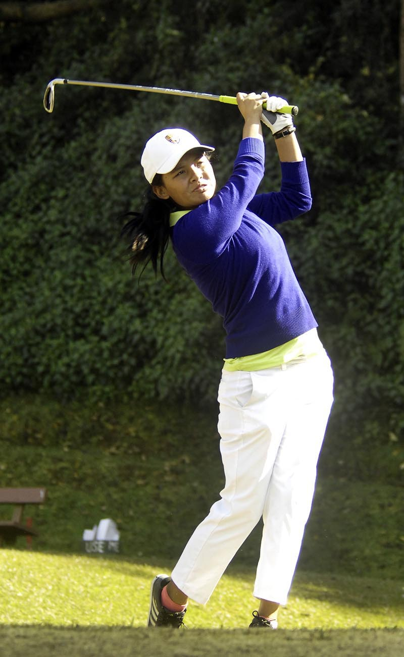 Pratima Sherpa watches the ball after hitting a tee shot on the 10th hole during the first round of the CMS Faldo Series Nepal Championship at the Gokarna Golf Club on Monday, December 11, 2017. Photo: Naresh Shrestha/THT