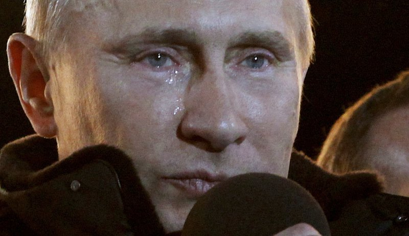 FILE In this file photo taken on Sunday, March 4, 2012, Russian Prime Minister Vladimir Putin, who claimed victory in Russiau2019s presidential election, reacts at a massive rally of his supporters at Manezh square outside Kremlin, in Moscow, Russia. PAfter 18 years as Russiau2019s leader _ and with another six-year term sure to follow a March election _ Putin doesnu2019t show the appetites or vulnerabilities that can personalize Western politics, even when staged or spun. If he has moments of merriment or melancholy, they happen in private. (AP Photo/Ivan Sekretarev, File)