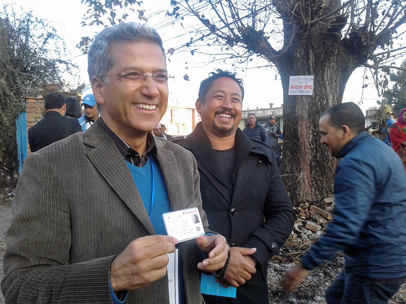Journalist turned politician and parliamentary candidate from Kathmandu Constituency-1, Rabindra Mishra, smiles showing his voter id card for the phase II provincial and parliamentary elections, in Kathmandu, on Thursday, December 7, 2017. Photo: Balkrishna Thapa Chhetri