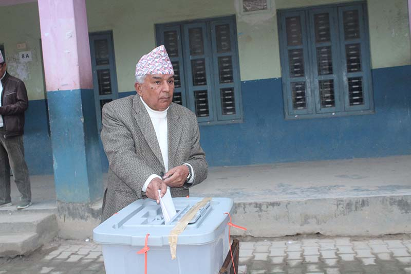 Nepali Congress senior leader Ram Chandra Paudel casts his ballot from Satyawati Secondary School polling station in Tanahun Constituency 1 (B), on Thursday, December 7, 2017. Photo: Madan Wagle