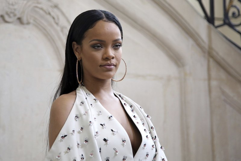 Singer Rihanna poses for photographers as she arrives to Christian Dioru2019s Spring-Summer 2017 ready-to-wear fashion collection presented in Paris. Rihanna is mourning the death of her cousin and calling an end to gun violence. The singer posted three photos of herself with 21-year-old Tavon Kaiseen Alleyne on Instagram on Tuesday, Dec. 26, 2017, writing that she u201ccanu2019t believe it was just last night that I held you in my arms!u201d Alleyne died Tuesday after being shot in Barbados, where Rihanna was born and raised