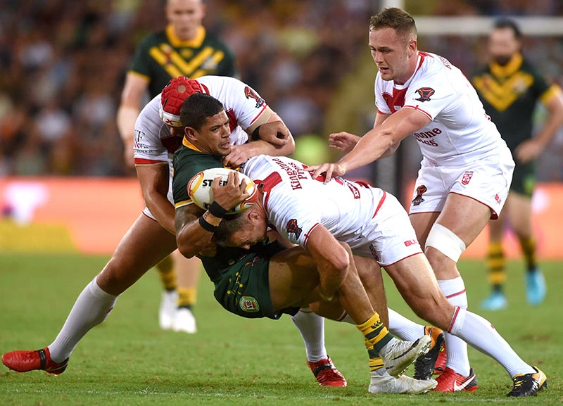 England's James Roby tackles Australia's Dane Gagai during their Rugby League World Cup final match between England and Australia, at Land Park, in Brisbane, Australia, on December 2, 2017. Photo: Reuters