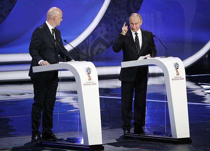 Russian President Vladimir Putin (right) is watched by FIFA president Gianni Infantino as he speaks before the 2018 soccer World Cup draw in the Kremlin in Moscow, on Friday, December 1, 2017. Photo: AP