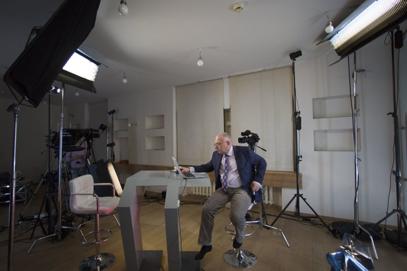 Dozhd Channel anchor Pavel Lobkov, prepares for a broadcast in their studio-apartment in Moscow, Russia. In December, 2015. Photo: AP