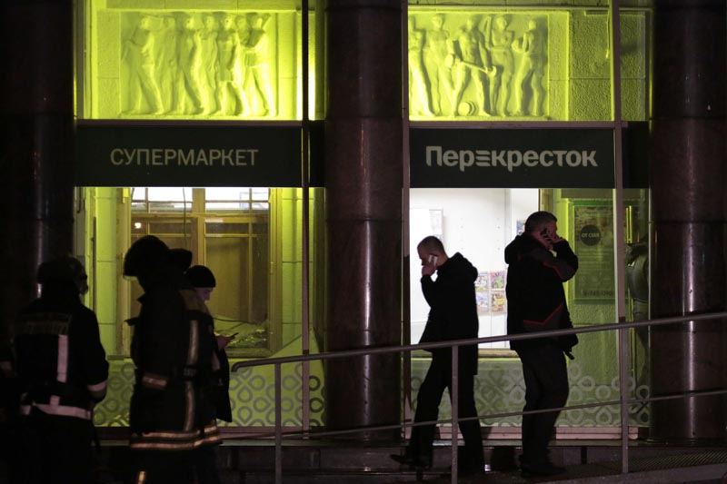 People gather outside a supermarket after an explosion in St Petersburg, Russia on December 27, 2017. Photo: AP