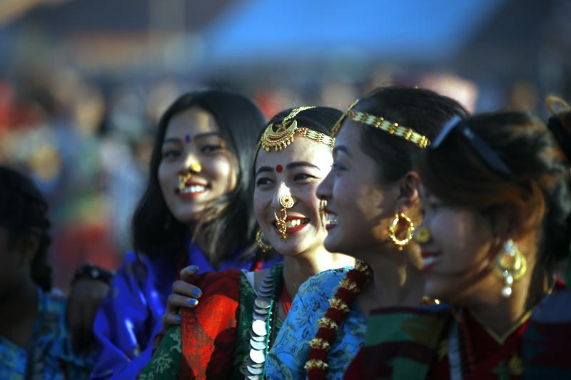 Nepali women from Kirat community dressed in traditional attire react as they perform Sakela dance during Udhauli festival in Kathmandu, on Saturday, December 09, 2017. Photo: Skanda Gautam