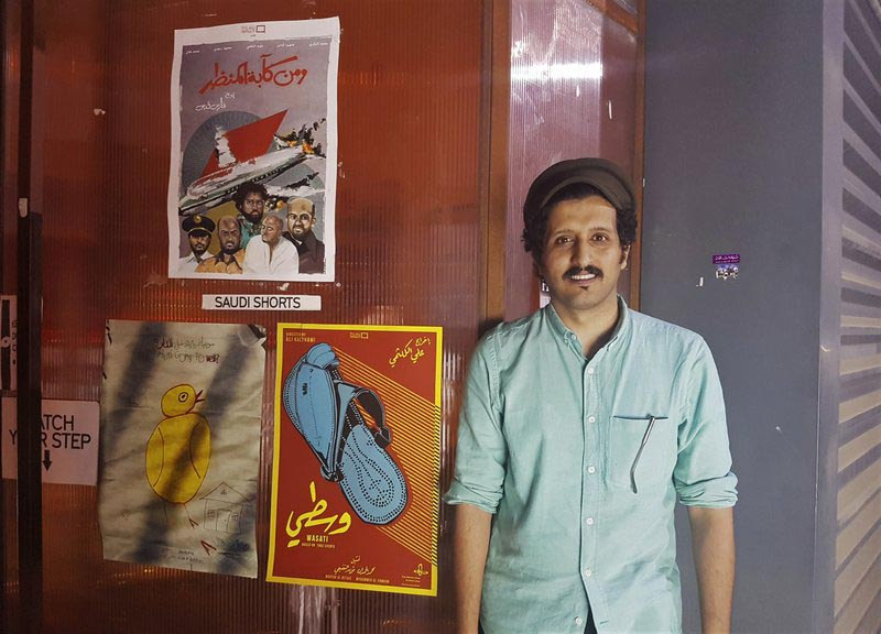Saudi filmmaker Ali Kalthami stands next to the poster for his film u201cWasatiu201d or u201cModerateu201d and two other Saudi short films recently shown at Cinema Akil in Dubai, United Arab Emirates, on Friday, August 25, 2017. Photo: AP