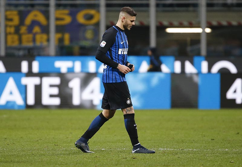 Inter Milan's Mauro Icardi walks off the field at the end of the Serie A soccer match between Inter Milan and Lazio, at the Milan's San Siro stadium, Italy, on Saturday, December 30, 2017. Photo: AP