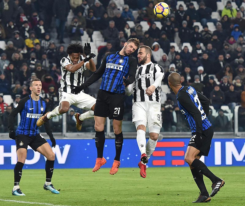 Juventus' Gonzalo Higuain (second from right), and Inter Milan's Davide Santon (centre), and Juventus' Juan Cuadrado (second from left), vie for the ball during a Serie A soccer match between Juventus and Inter Milan at the Allianz Stadium in Turin, Italy, on December 9, 2017.  Photo: Alessandro Di Marco/ANSA via AP