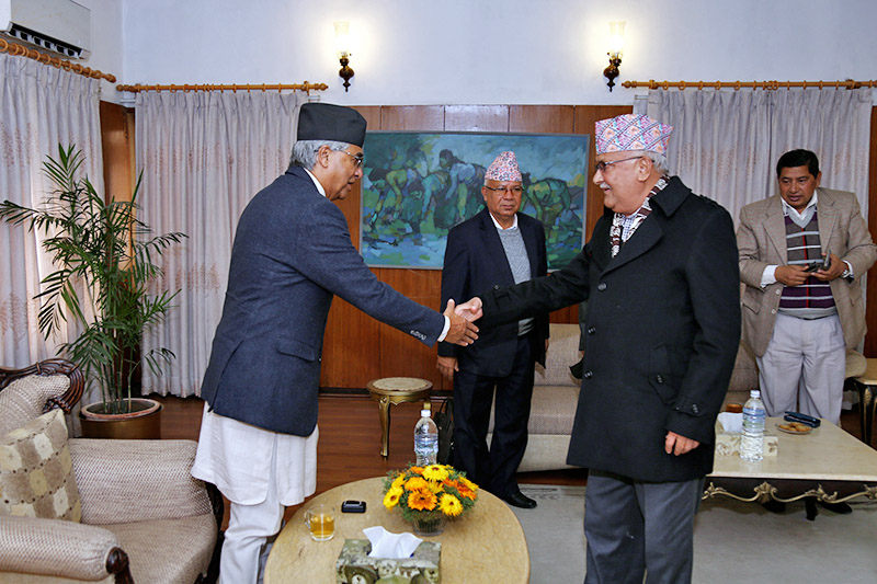 PM Sher Bahadur Deuba welcomes KP Sharma Oli and other leaders for five party meeting at Baluwater, in Kathmandu, on Friday, December 22, 2017. Photo: RSS