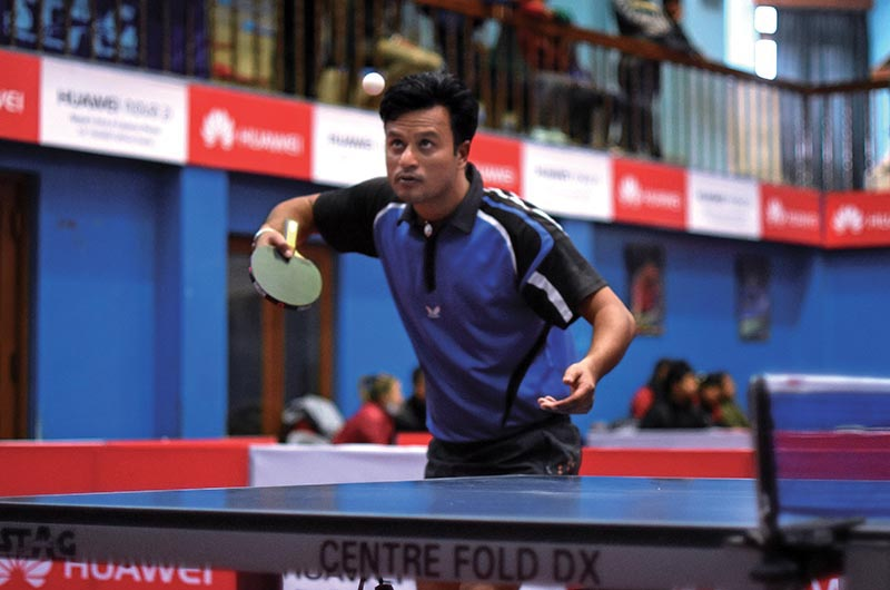 Shiva Sundar Gothe serves to Amar Lal during their menu2019s singles match of the iMPACT Thamel Open Table Tennis Championship in Kathmandu on Friday. Photo: THT
