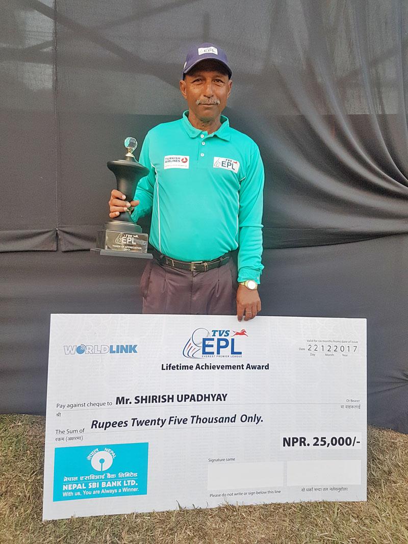 EPL Pvt Ltd on Tuesday honoured Former cricketer and umpire Sirish Upadhayaya with the Lifetime Achievement Award here at the TU Stadium. Photo: THT