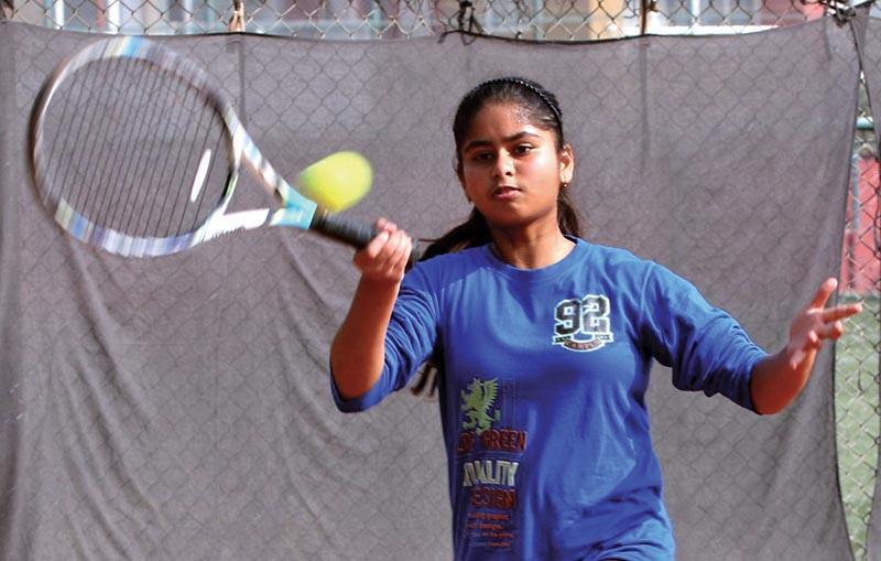Sneha Yadav returns to Nimisha Dhakal during the 15th Jayakar Memorial National Junior Tennis Tournament in Lalitpur on Monday. Photo: THT