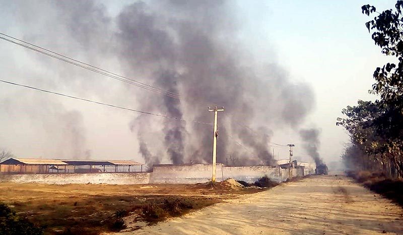 Clouds of thick black smoke billow after a massive fire break out in Super Gas Industry, in Patel Nagar of Birgunj Sub Metropolitan City-24, Parsa district, on Wednesday, December 20, 2017. Photo: Ram Sarraf