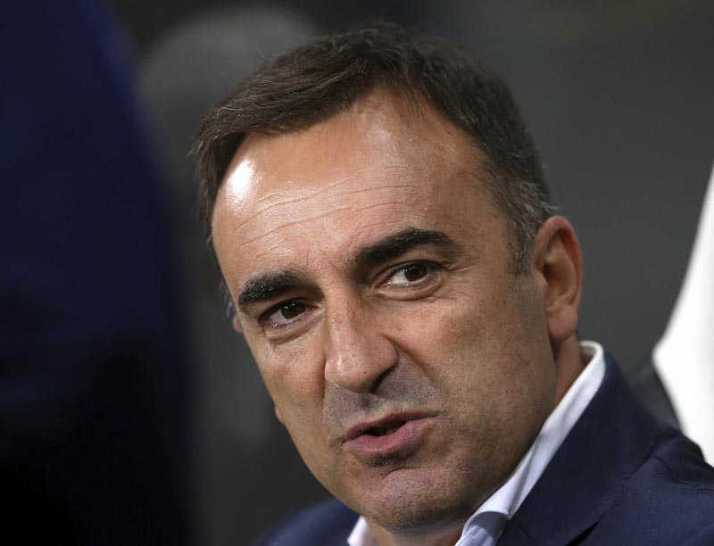 FILE - In this Wednesday, Sept. 23, 2015 file photo, Sheffield Wednesday's manager Carlos Carvalhal awaits the start of the English League Cup third round soccer match between Newcastle United and Sheffield Wednesday at St James' Park, Newcastle, England. Swansea has hired Carlos Carvalhal as manager of the struggling Premier League club, days after the Portuguese coach left second-tier Sheffield Wednesday. Photo: AP
