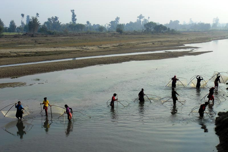Local women fishing in the Syali River in Ranipur village of Kanchanpur district, on Thurday morning, December 14, 2017. Photo: RSS