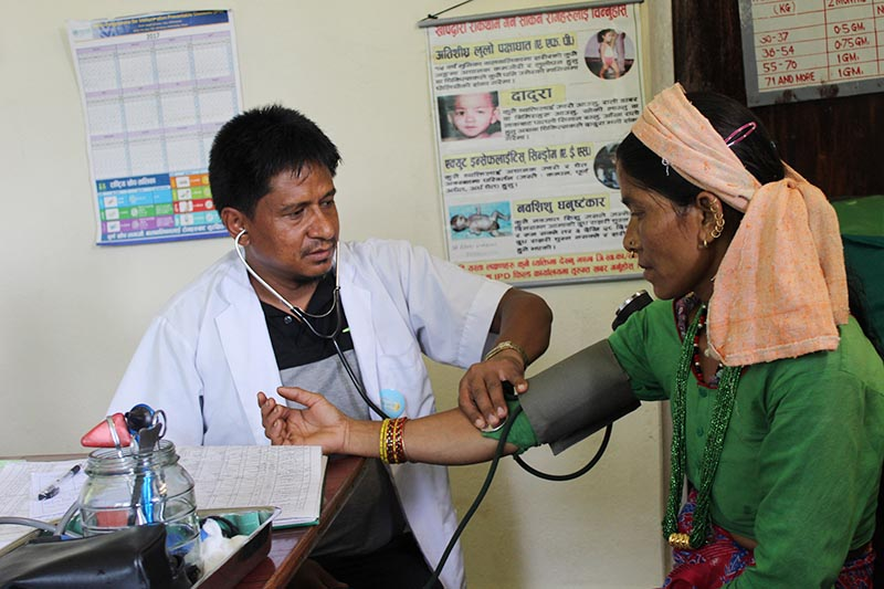 A health worker checking a patient at Tate Health Post in Bajura, on Tuesday, December 5, 2017. Photo: THT