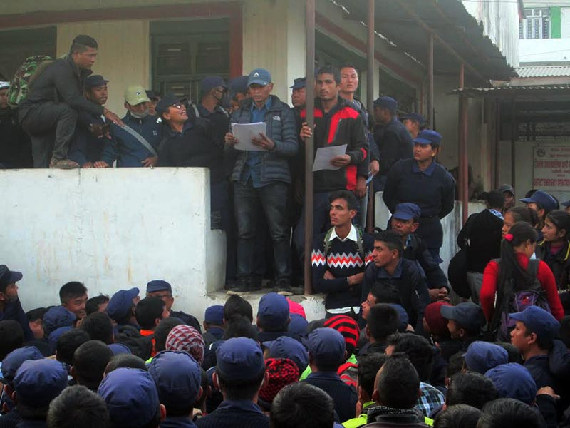 Certificates being distributed to temporary cops at District Police Office, Tanahun, on Friday, December 22, 2017. Photo: THT